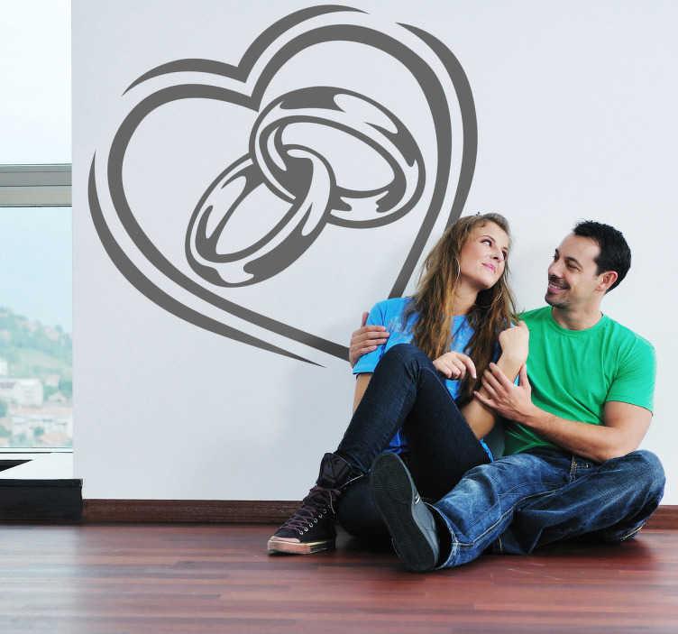 TenStickers. Ehe Aufkleber. Ein Herz mit Eheringen als Wandtattoo. Diese tolle Wanddeko ist ideal für frisch verheiratete Ehepaare. Persönliche Beratung