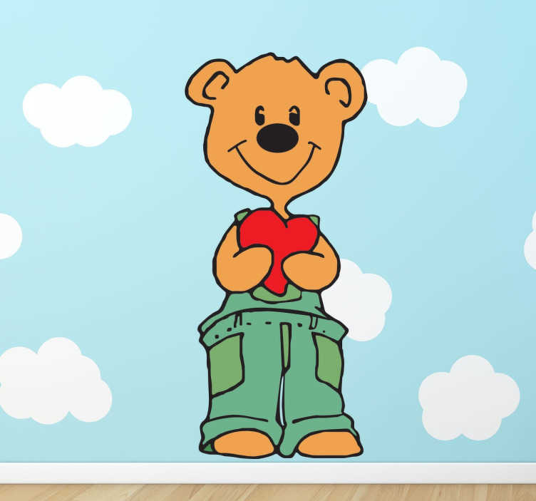 TenStickers. Muursticker van beer met hart. Decoratieve muursticker met een schattig ontwerp van een lieve beer met een hartkussen. Afmetingen aanpasbaar. 10% korting bij inschrijving.