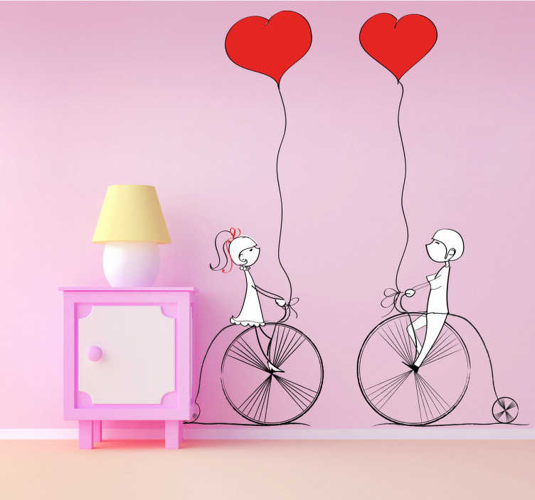 TenStickers. Couple Cycling with Balloons Sticker. Decorative love stickers showing a young couple cycling and holding heart shaped balloons. From our collection of love heart stickers.