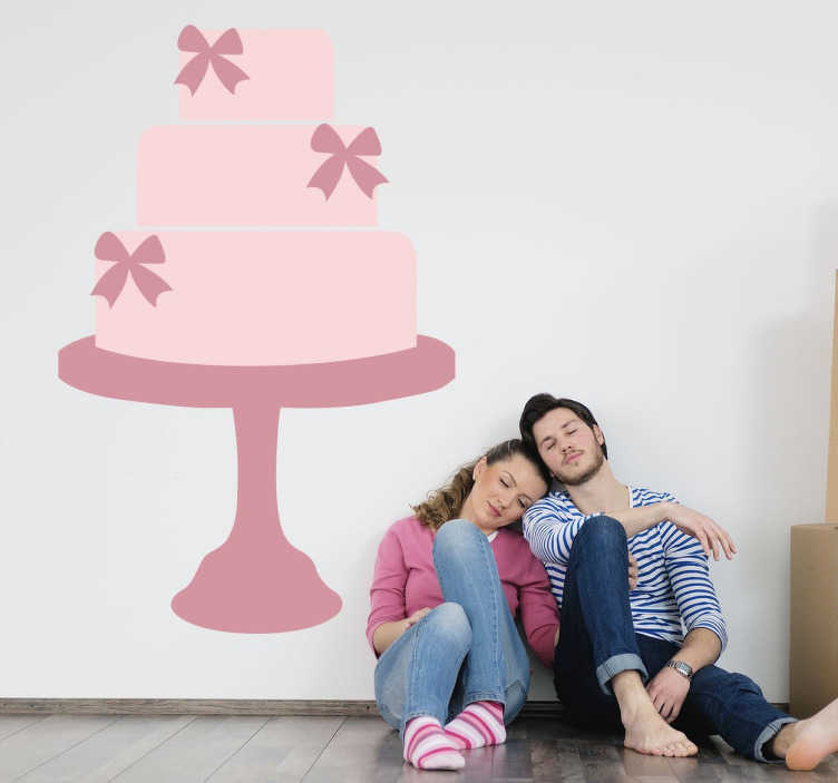 TenStickers. Pink Three Tier Cake Decal. Cake - Pink pastel illustration of a three tier cake decorated with bows. An ideal feature great for your kitchen or business