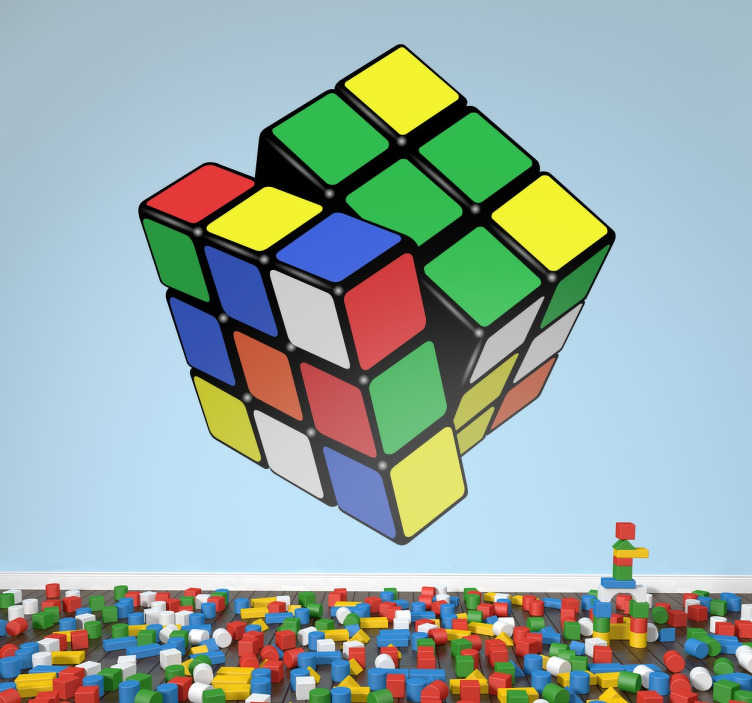 TenStickers. Sticker 3D Rubik´s kubus kleur. Deze Rubik´s kubus met kleur sticker lijkt wel uit je muur te komen! Deze 3D sticker is op zo een manier gemaakt dat het een visueel effect geeft.