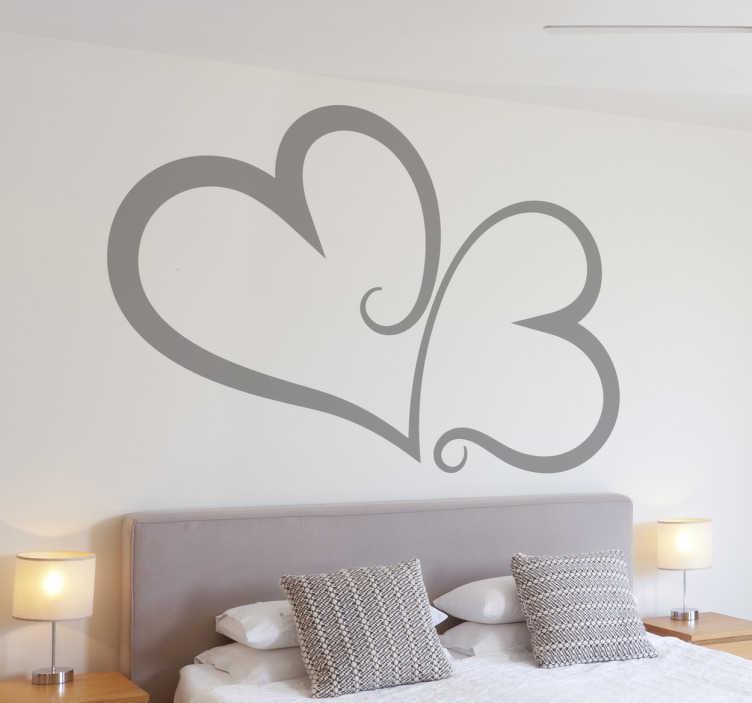 TENSTICKERS. 連動した心の壁のステッカー. あなたの寝室を飾るために心臓のステッカーのコレクションから2つのインターロックされた心を示す素晴らしいモノクロの壁のステッカー!このヘッドボードのステッカーはあなたの家に暖かく愛情のある雰囲気を提供し、残りのデザインを確認します。