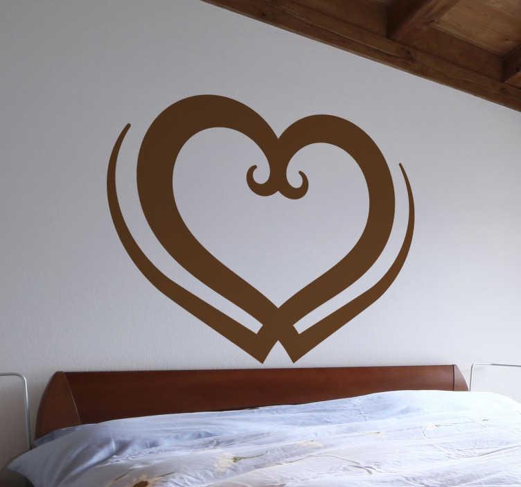 TenVinilo. Vinilo decorativo tribal forma corazón. Vinilos de inspiración romántica ideales para decorar habitaciones de matrimonio.