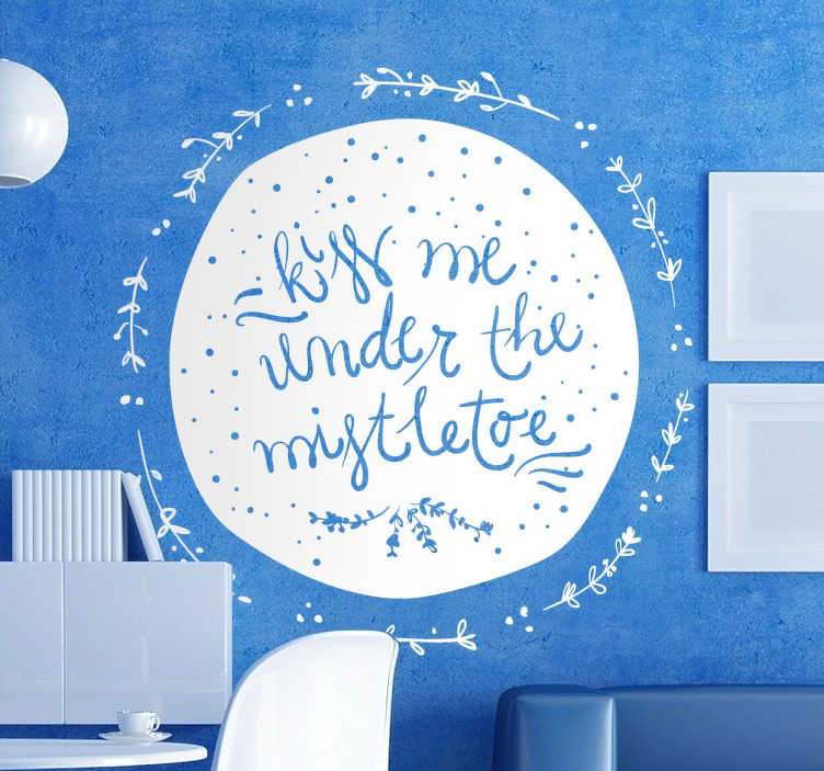TenStickers. Kiss Me Mistletoe Christmas Sticker. Christmas vinyl decal with a cheeky design with a text inviting your guests to kiss under the mistletoe.