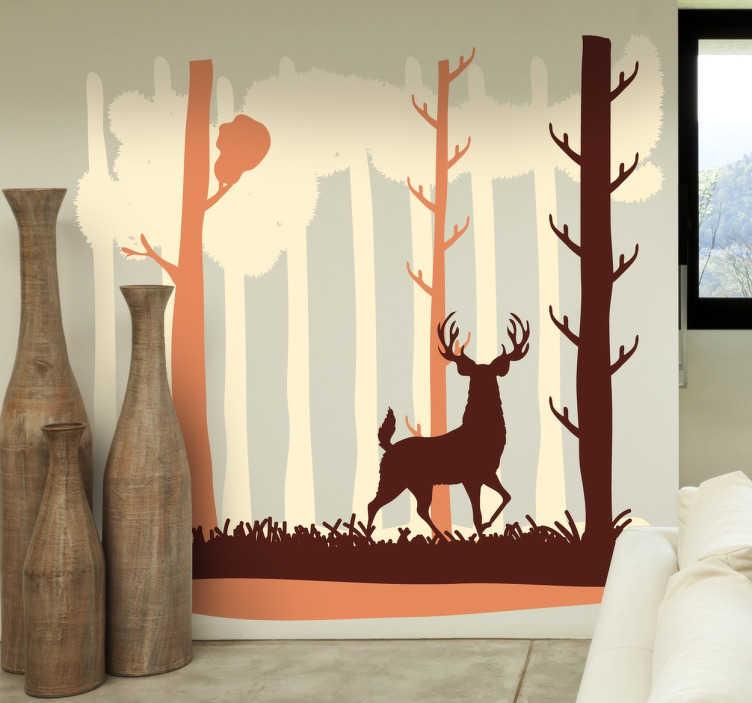 TenStickers. Naklejka dostojny jeleń. Winylowa naklejka na ścianę przedstawiająca sylwetkę brązowego jelenia tle lasu, który wpatruje się w nas badawczo.