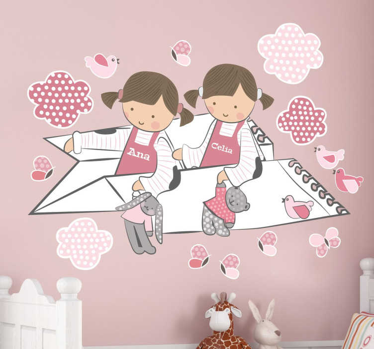 TenStickers. Two Girls Personalised Kids Wall Sticker. Playful pink personalised kids wall sticker showing two little girls flying past the birds and clouds on a paper aeroplane while holding their teddy bears. This polka dot wall sticker can be customised to show any name on the girls' dresses in any size you want.