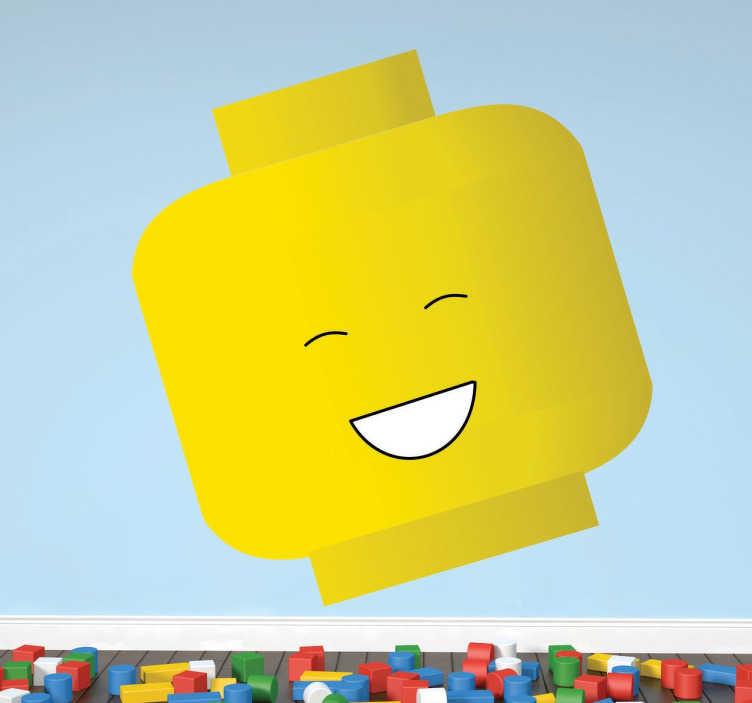 TenStickers. Naklejka uśmiechnięte Lego. Naklejka dekoracyjna dla dzieci przedstawiająca klocek lego z usmiechniętą minką. Idealna dekoracja dla ckłopaków i dziewczynek.