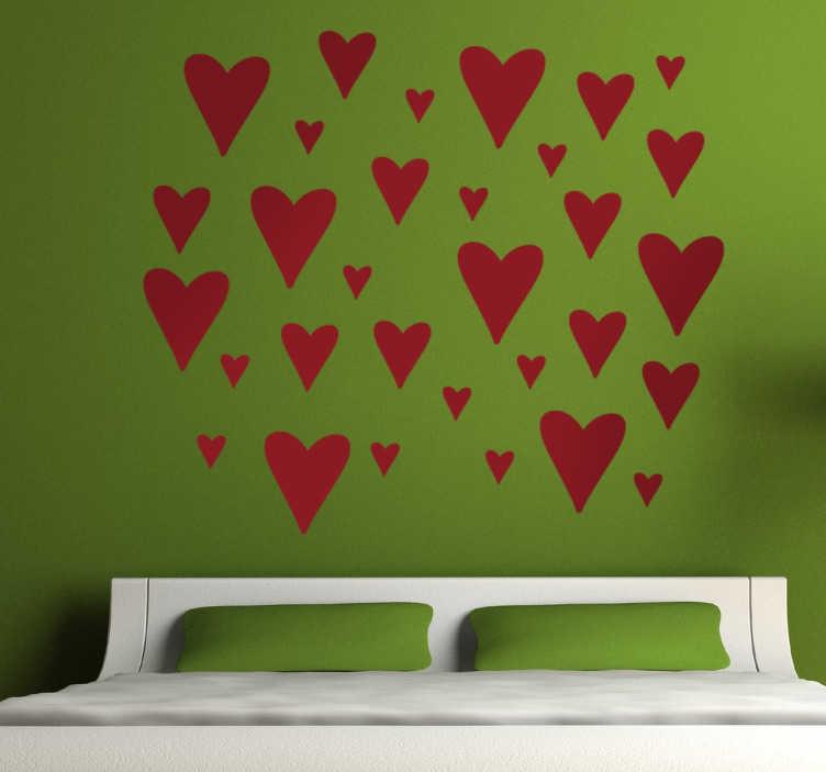 TenStickers. Naklejki na ścianę serca. Naklejki na ścianę z kolekcją serduszek w różnych rozmiarach. Naklejki na ścianę na Walentynki do przyklejenia w sypialni lub salonie.