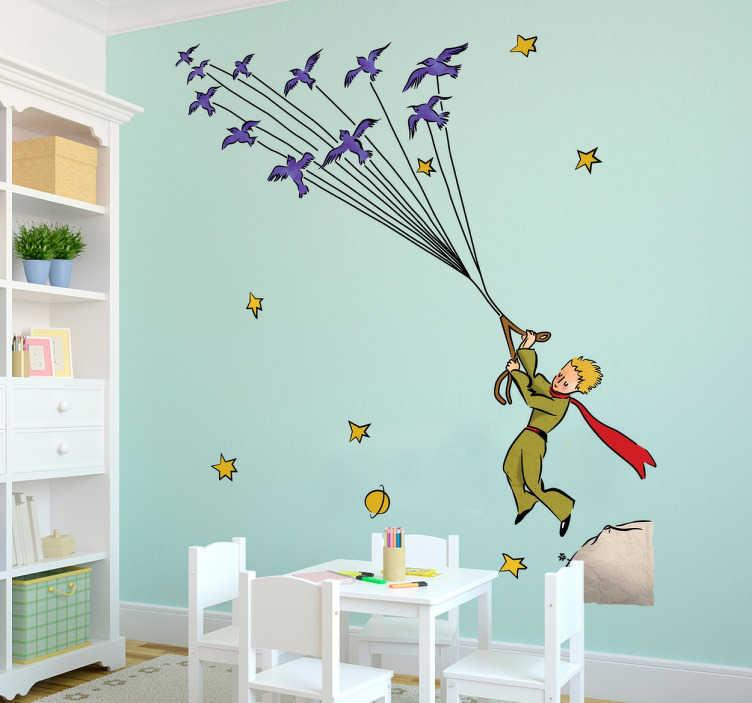 TenVinilo. Vinilo infantil principito volando color. Murales y vinilos para habitaciones infantiles con una representación del famoso cuento de Antoine Saint-Exupéry.