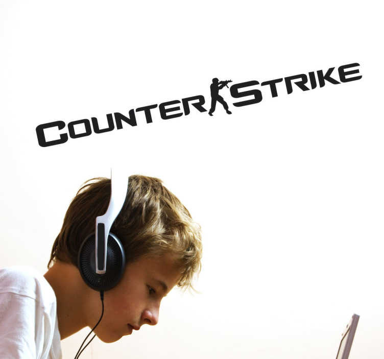TenStickers. Naklejka dekoracyjna logo Counter Strike. Naklejka na ścianę z logo jednej z najsławniejszych gier komputerowych czyli gra Counter Strike. Naklejka dla wszystkich fanów gry.