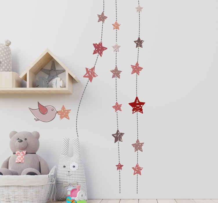 TenVinilo. Vinilo infantil ave colgantes estrellas. Vinilos para habitación infantil con el dibujo de un pájaro con una estrella en su pico y colgantes en tonos pastel.