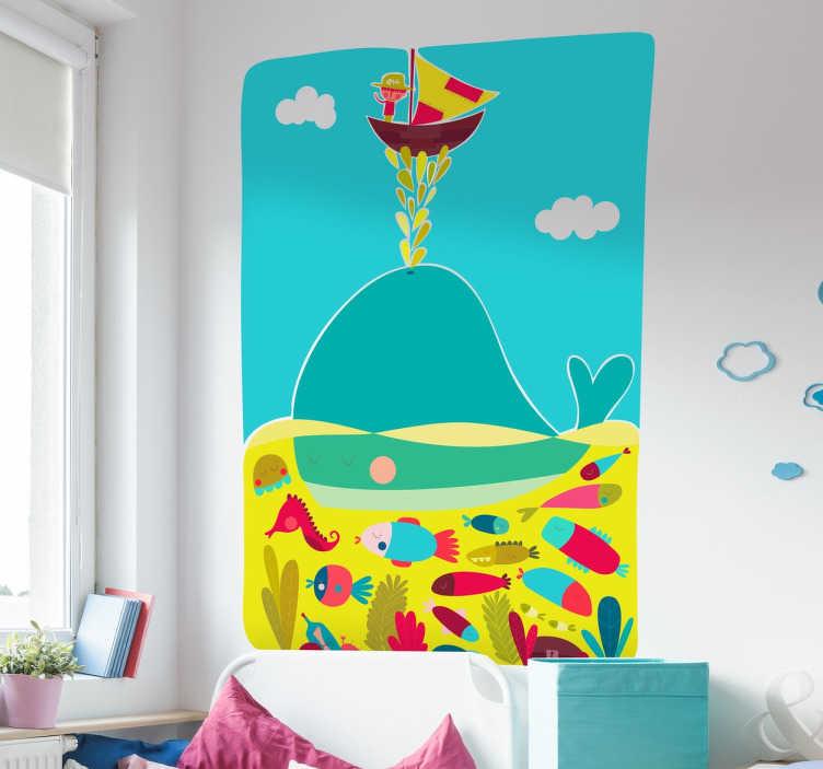 TenStickers. Wandtattoo Wal. Das Wandtattoo illustriert einen Wal, der ein Schiff balanciert; unter dem Wal ist die Unterwasserwelt mit verschiedenen Fischarten abgebildet.