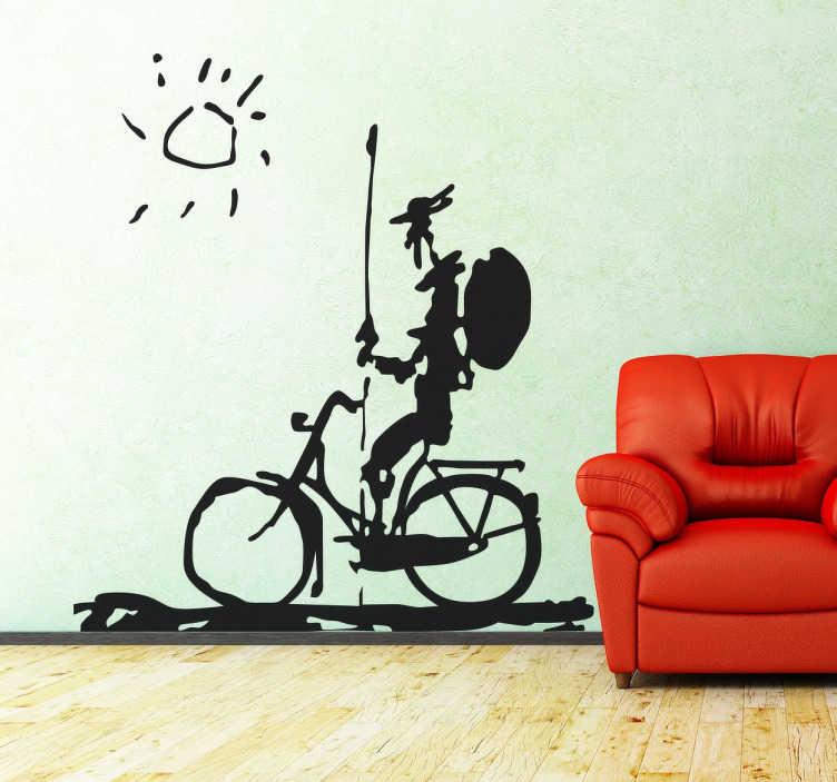 TenStickers. Vinil decorativo D. Quixote na biclicleta. Autocolante decorativo de D. Quixote de la Mancha a andar de bicicleta, levando o seu escudo, a sua lança e a sua armadura.