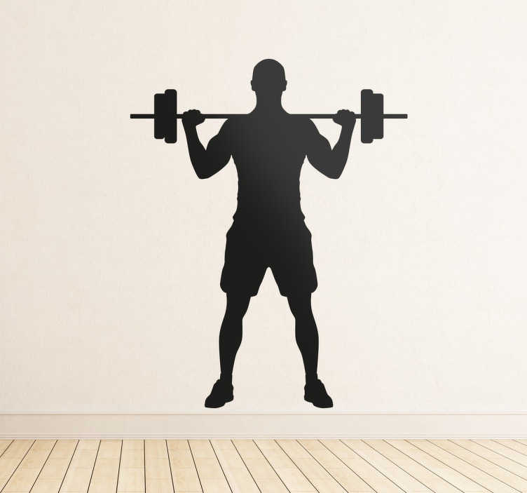 TenStickers. Wandtattoo Sportler Langhanteldrücken. Sportliches Wandtattoo für Ihr Zuhause. Auf dem Wandtattoo ist ein Sportler abgebildet, der gerade die Übung Langhanteldrücken im Stehen ausführt.