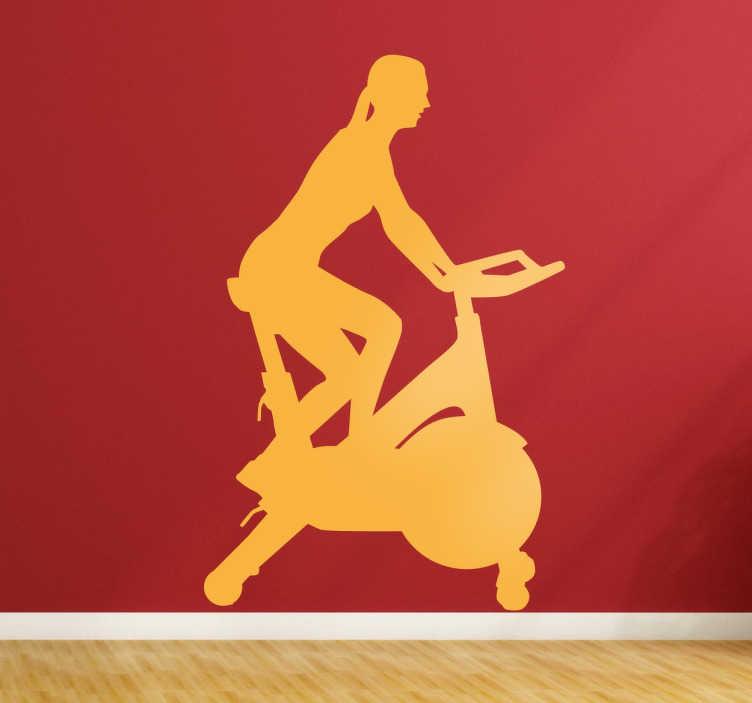 TenStickers. Autocolante ginásio mulher bicicleta. Vinil decorativo da nossa coleção de desporto e fitness, com uma silhueta de uma mulher a fazer exercício na sua bicicleta.