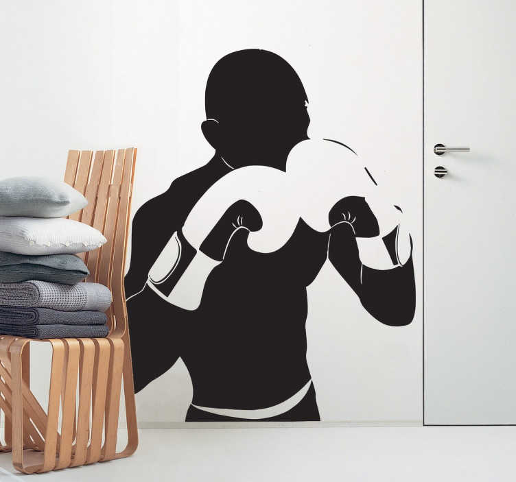TenStickers. Boxer Silhouette Wall Sticker. Sports sticker showing the silhouette of a boxer with his gloves raised in a guarding position. This boxing wall sticker is ideal for you to place on any flat surface and make your space more suited to your tastes.