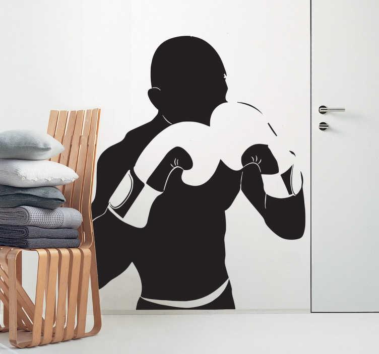 TenStickers. Boksör siluet duvar sticker. Koruyucu bir pozisyonda kaldırdı eldivenleri ile bir boksör silueti gösteren spor etiket. Bu boks duvar etiketi, herhangi bir düz yüzeye yerleştirmeniz ve mekanınızı zevkinize daha uygun hale getirmeniz için idealdir.