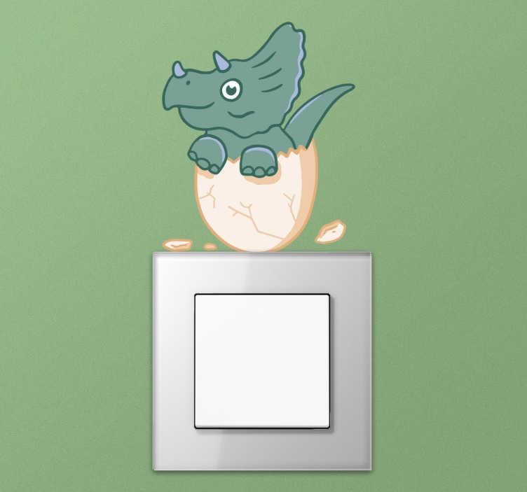 TenStickers. Lichtschalteraufkleber lachender Dinosaurier. Verzieren Sie Ihre Steckdosen und Lichtschalter mit diesem Aufkleber. Das Wandtattoo zeigt die Silhouette eines grinsenden Dinosauriers.