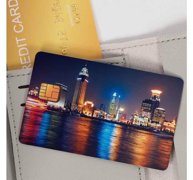 TenVinilo. Vinilo tarjeta de crédito city at night. Ahora puedes personalizar tarjeta de crédito con un vinilo de una ciudad iluminada por la noche. Ideal si quieres dar un toque distinto a tu tarjeta.