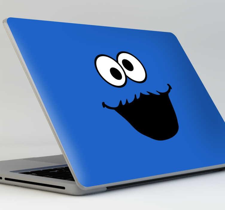 TenVinilo. Vinilo portátil monstruo galletas. Pegatinas para personalizar tu portátil con tu personaje de Barrio Sésamo favorito, el monstruo azul devorador de galletas de nombre Triqui.