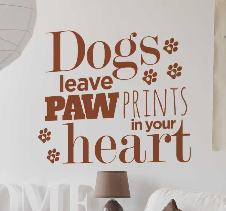 """TenVinilo. Vinilo decorativo paw prints. Vinilos de texto en inglés con el texto """"los perros dejan huella en tu corazón""""."""