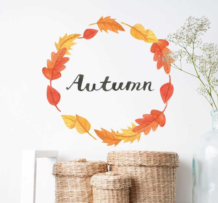 TenStickers. Dekoracja jesień. Dekoracja ścienna przedstawiająca wianek stworzony z jesiennych liści a w środku mieści się napis w języku angielskim,który w języku polskim oznacza jesień.