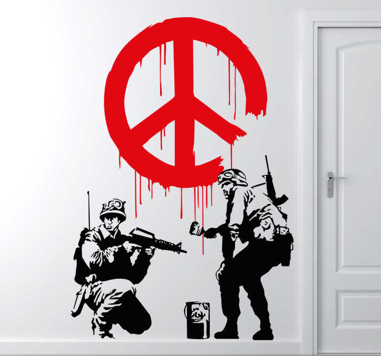 TenStickers. Banksy Peace Sticker. Created by Banksy the sticker shows two soldiers, one painting a peace sign on the wall while the other keeps a look out.