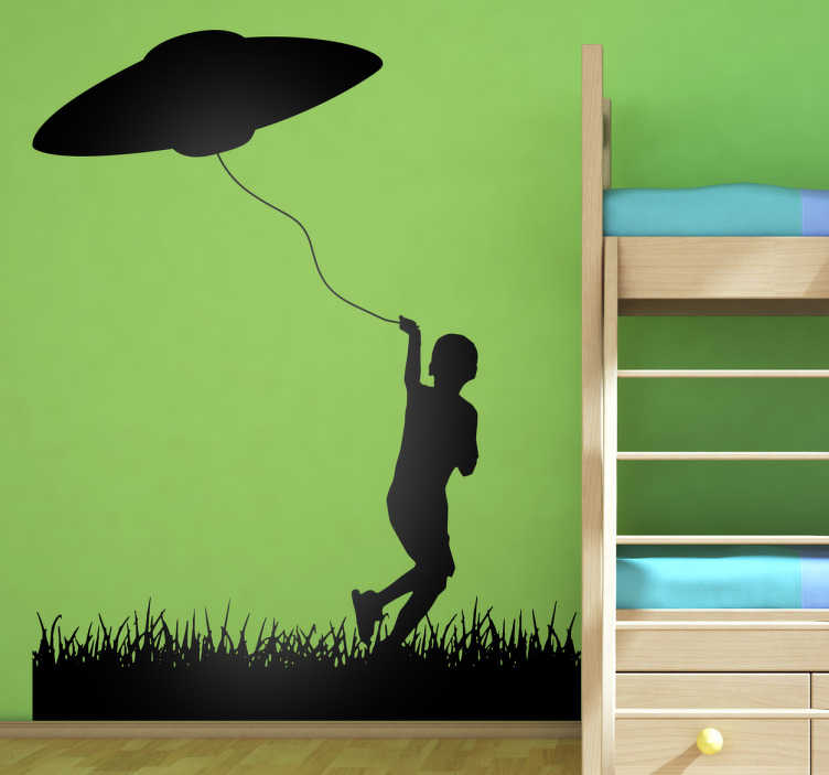 TenStickers. UFO Kite Wall Sticker. This wall sticker consists of a little boy running around in the grass, flying his kite. The kite just so happens to be a UFO.