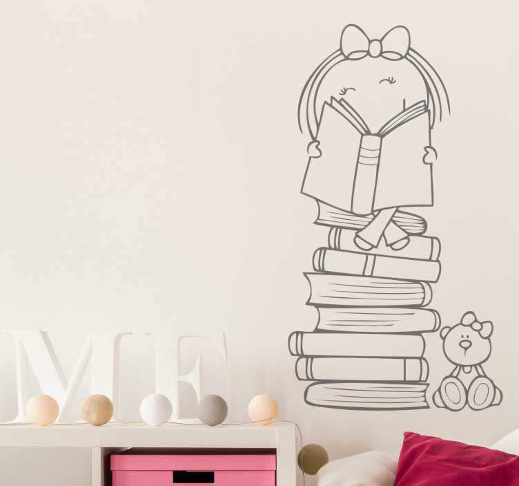 Tenstickers. Tjej som läser en boks barns klistermärke. Om dina barn älskar att läsa, skulle det här dekalet som visar en tjej som läser en bok på en hög med böcker vara perfekt för att dekorera sitt rum!
