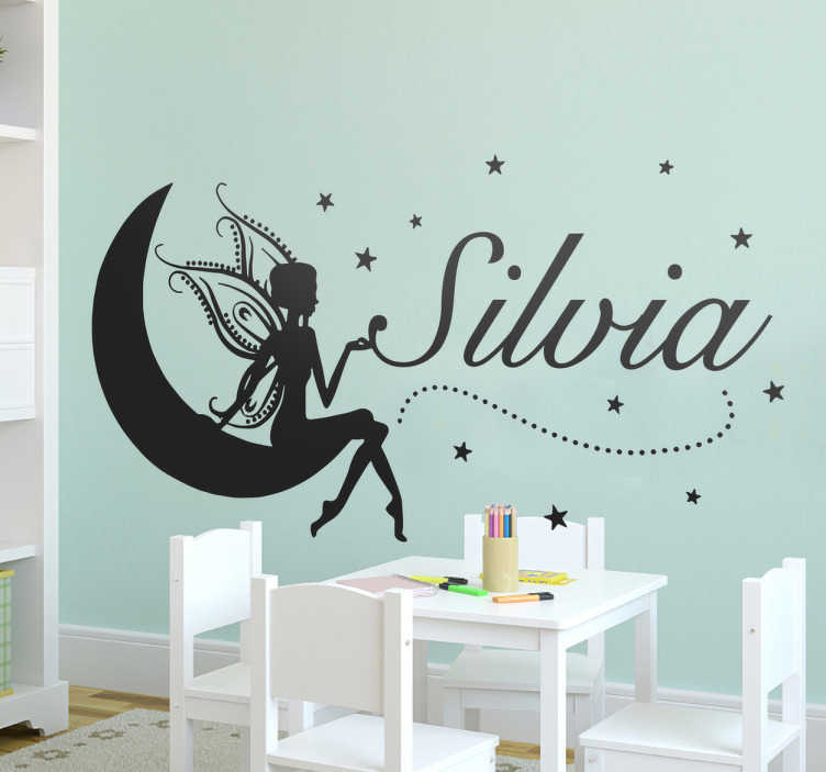 TenStickers. Personalised Fairy Wall Sticker. Personalised kids wall sticker of a fairy sat on a crescent moon with your child's name surrounded in stars. Personalise your child's bedroom with this enchanting text sticker and add a touch of magic to your home decor.