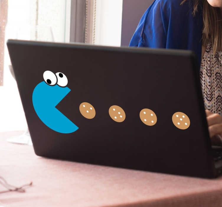 TenStickers. Naklejka Ciasteczkowy potwór pożerający ciastka. Naklejka na laptopa, która przedstawia ciasteczkowego potwora jedzącego ciastka.