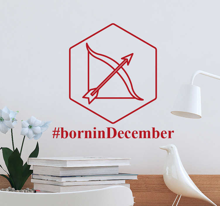 "TenStickers. Born in December Sagittarius Wall Sticker. This simple and original astrology wall sticker is perfect for decorating and personalising the walls of any Sagittarius' home, featuring the symbol of the star sign Sagittarius, a bow and arrow inside a hexagon, alongside the text ""#borninDecember""."