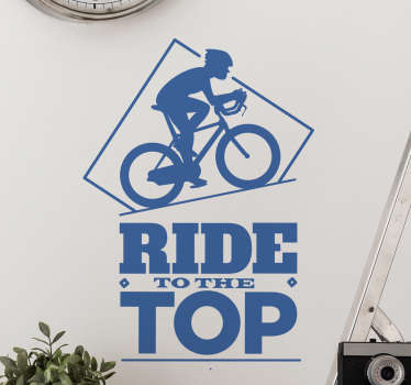 "Cycling Wall Sticker. The wall sticker consists of the text ""Ride to the top"" with a cyclist pedalling up a steep hill."