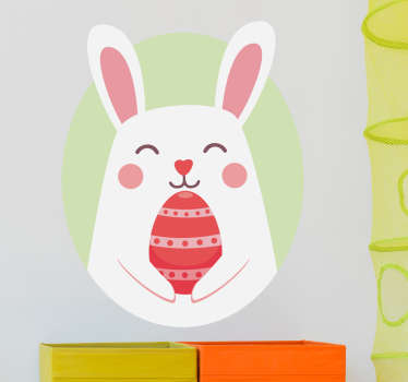 A wall sticker for children in which the Easter Bunny is holding a coloured egg. A nice wall decoration for Easter.