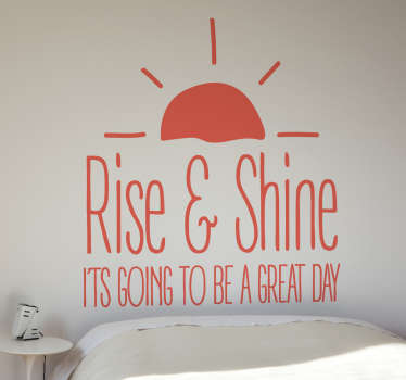 "Sticker motivacional con la frase ""Rise and Shine.It's going to be a great day"", coronada por un sol naciente."