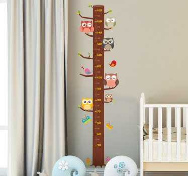 Height chart wall sticker showing a tree trunk and multiple owls resting on each branch. Use the measurements up the middle to keep track of your child's height as they grow!