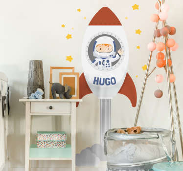 Personalised kids wall sticker showing a cute astronaut in his rocket blasting off to space to see the stars, from our collection of space wall stickers. This personalised sticker allows you to put any name you like on the rocket allowing for a completely personalised look for your child's bedroom.