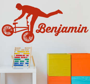 Cycling wall decal of a silhouette young acrobat doing tricks on his bicycle. Available in more than 45 different colors.