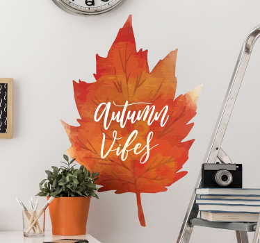 Bring the atmosphere of autumn into your home with this sticker showing an orange leaf typical of autumn with the English phrase Autumn Vibes!