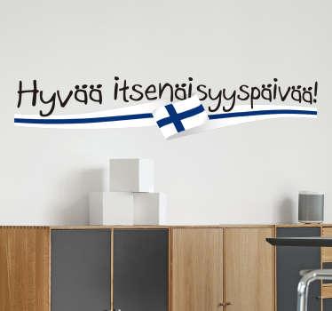Suomen itsenäisyyspäivä sisustustarra. Koristetarra, jossa on Suomen lippu ja, jolla toivotetaan kaikille Hyvää itsenäisyyspäivää.