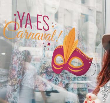 """Vinilo Carnaval original y colorido con el dibujo de una máscara veneciana y el texto """"YA ES CARNAVAL"""" en la parte superior."""