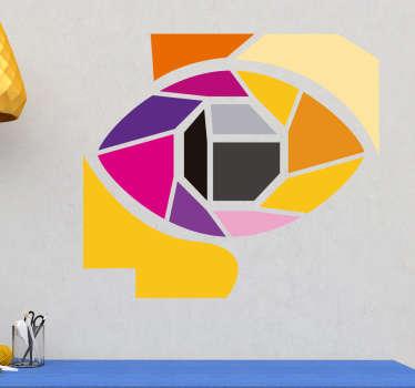 Sticker mural représentant un oeil dans un style mosaïque coloré. Idéal pour apporter une touche de vie à votre salon ou toute autre pièce.