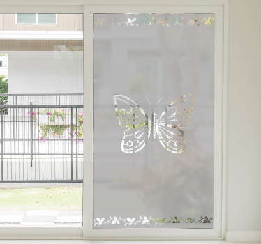 Decorate your window with a beautiful window sticker of an elegant butterfly and floral decorations on the top and bottom of the sticker.