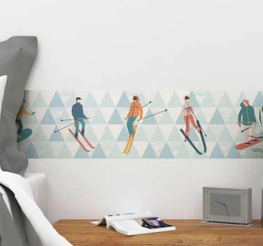 Skiers border wall vinyl decal with different skiers to decorate flat wall space in the home. It is available in any size needed.