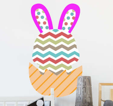 Easter holiday wall sticker with the design of a colorful bunny to decorate the home during festivity. It is easy to apply and self adhesive.