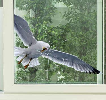 Lintu lentää ikkunaan ikkunatarra