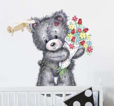 Decoreer de kinderkamer met deze muursticker waar een schattige beer met een boeket in zijn handen op is afgebeeld. Voordelig personaliseren.