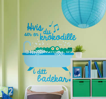 "This kid's room sticker depicts a crocodile in a bathtub with the lyrics of the song ""Hvis du ser en krokodille"". Your kids will surely love it!"