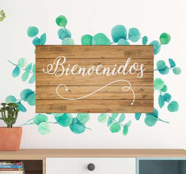 """Vinilo formado por el texto """"Bienvenidos"""" sobra una lámina de manera y hojas de eucalipto a su alrededor. Compra Online Segura y Garantizada."""
