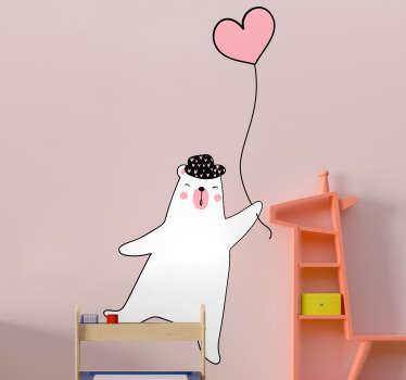 Adesivo decorativo da parete per bambini con il design originale di un orso polare con mongolfiera. Facile da applicare e disponibile in diverse dimensioni.